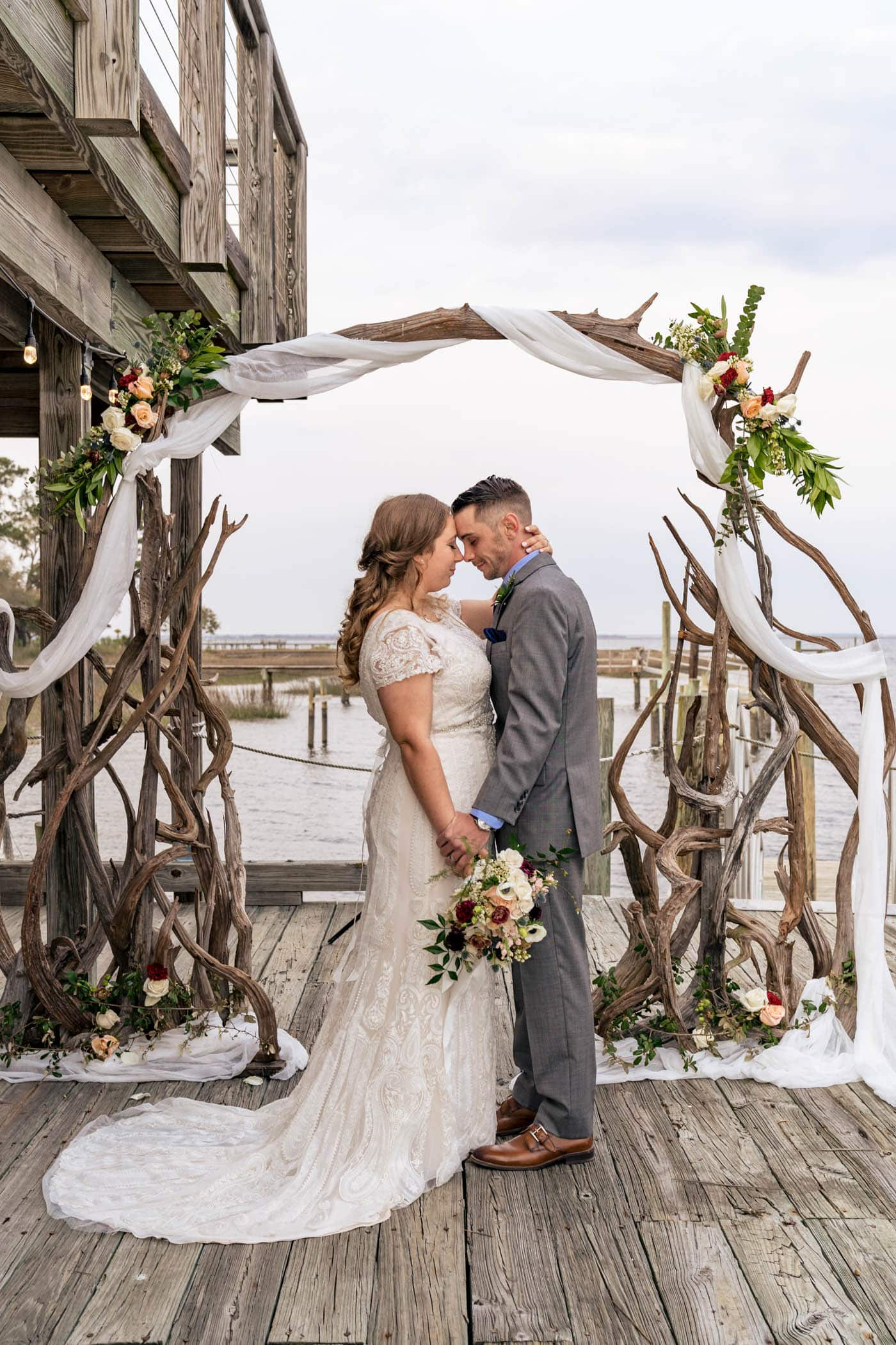 bride and groom portrait driftwood arch