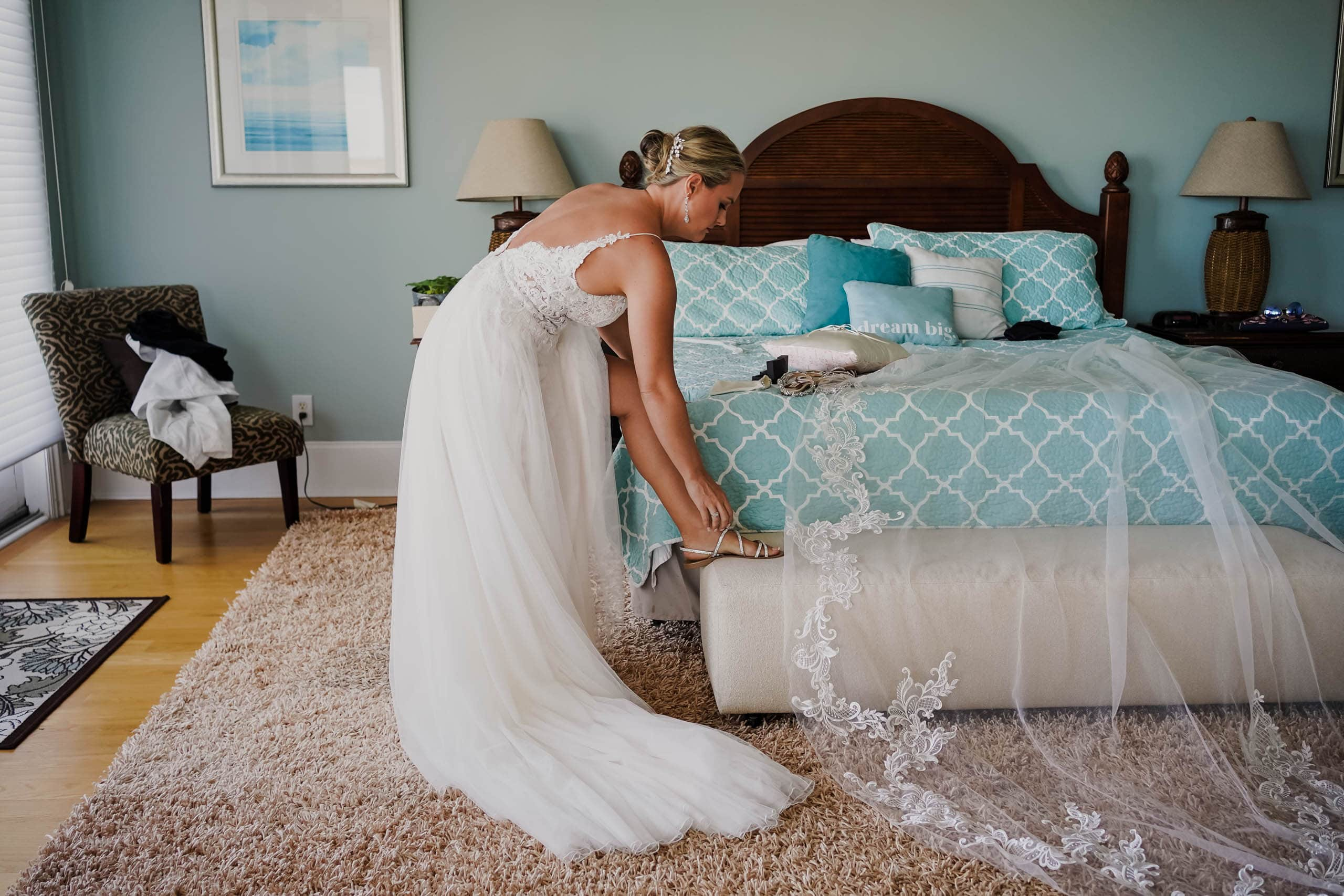 Bride getting ready for beach ceremony in rental house on Fripp Island by Susan DeLoach Photography SC Wedding Photographer
