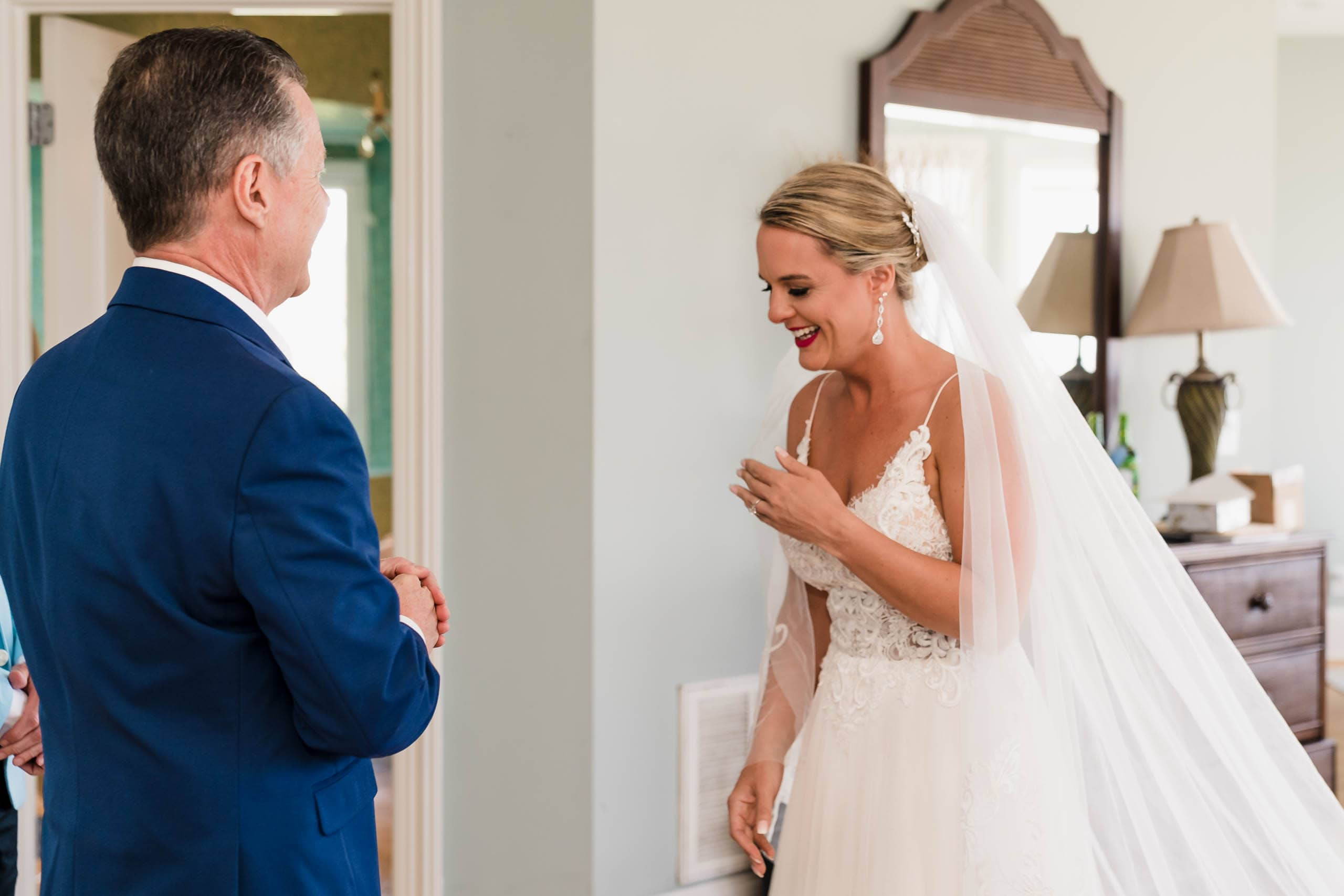Bride with father during first look in beach house on Fripp Island by Susan DeLoach Photography SC wedding photographer
