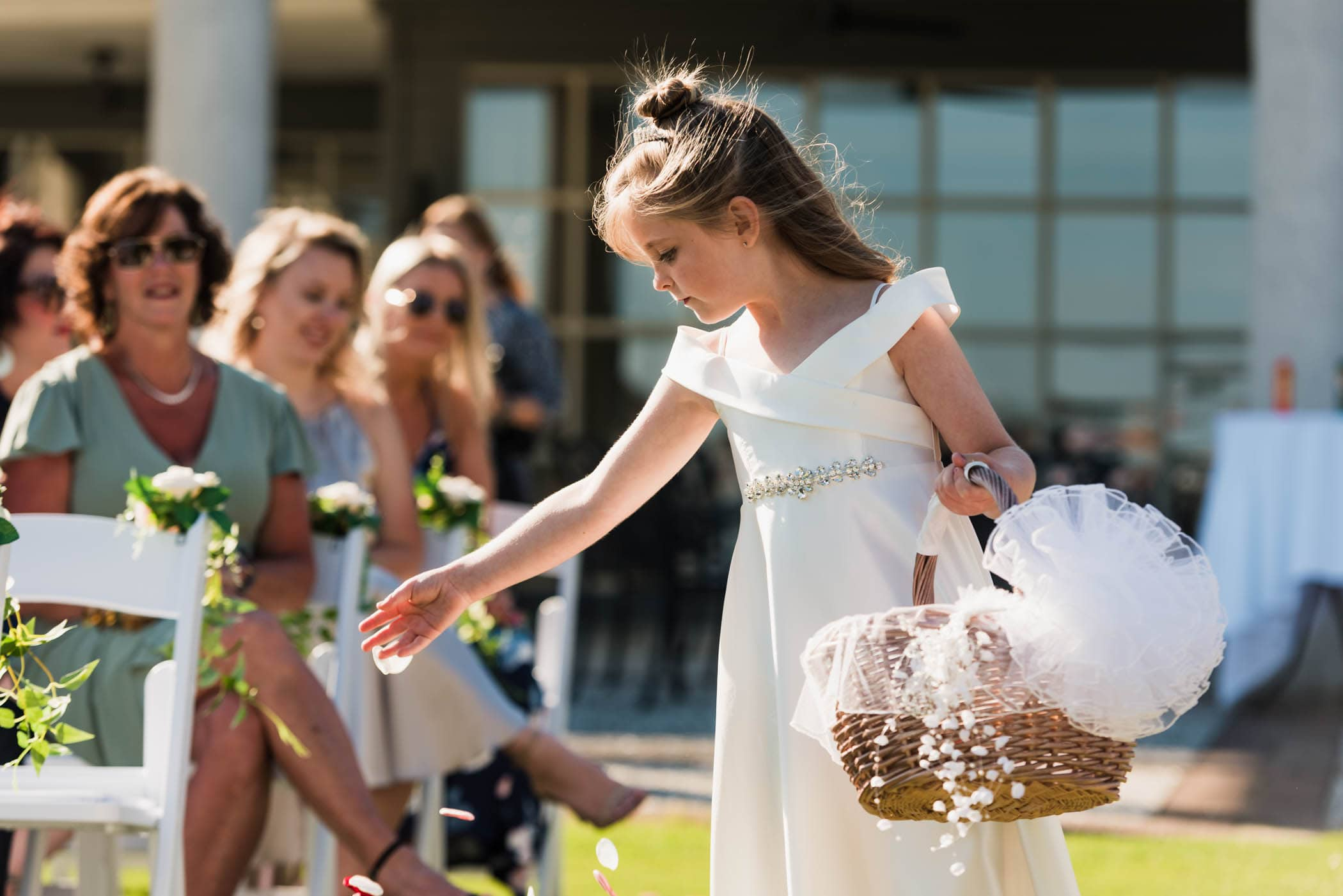 Flower girl throwing flower petals during wedding ceremony by Susan DeLoach Photography SC wedding photographers