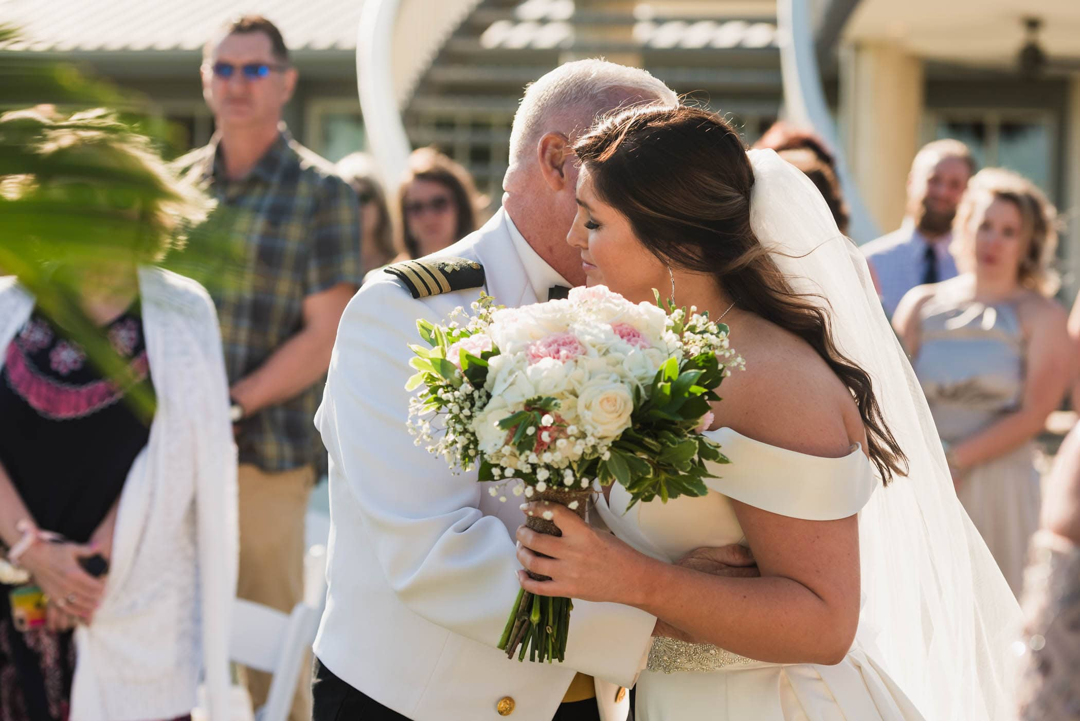 Bride kisses father at the end of the isle during wedding ceremony Dataw Island Club House by Susan DeLoach Photography SC wedding photographers