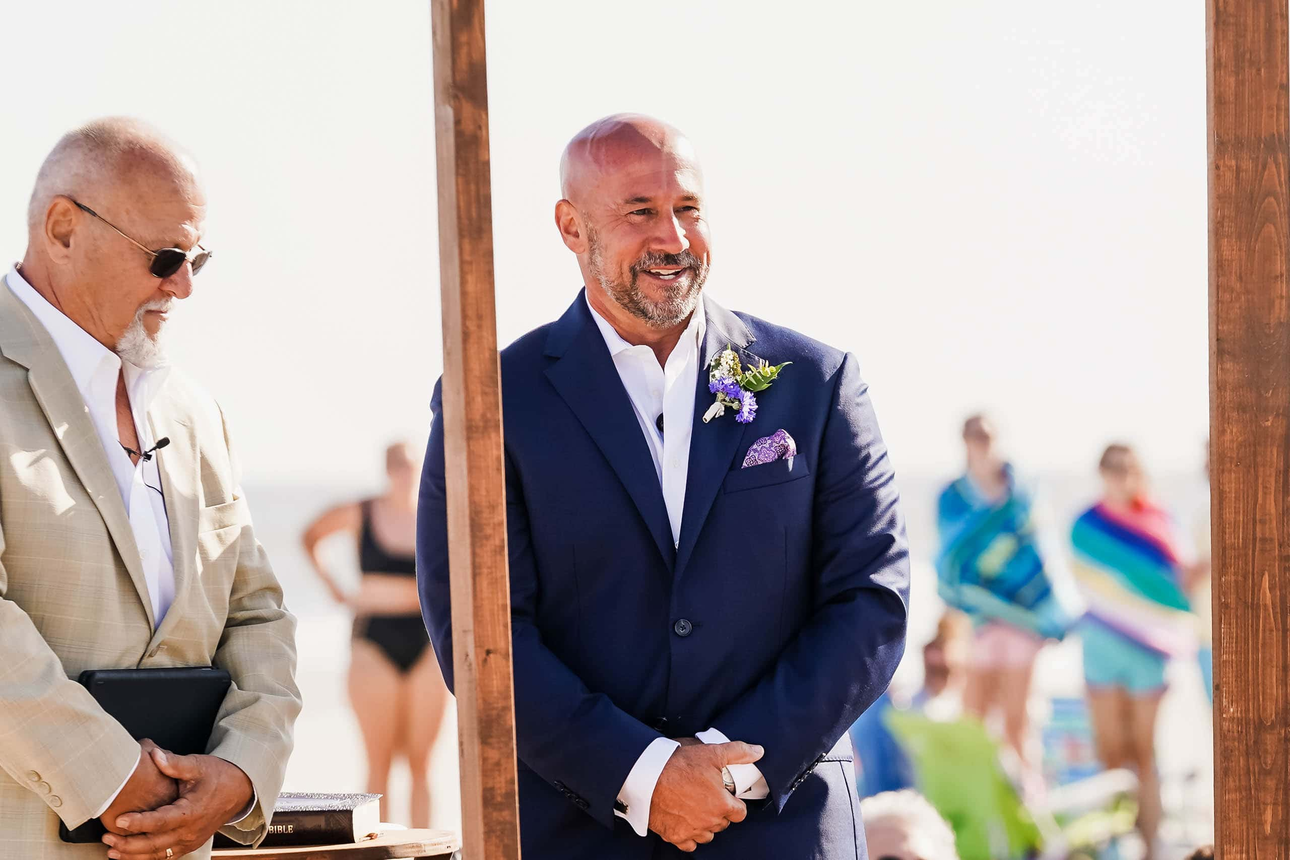 Groom on the beach seeing Bride walk down isle on Fripp Island by Susan DeLoach Photography SC Wedding photographer