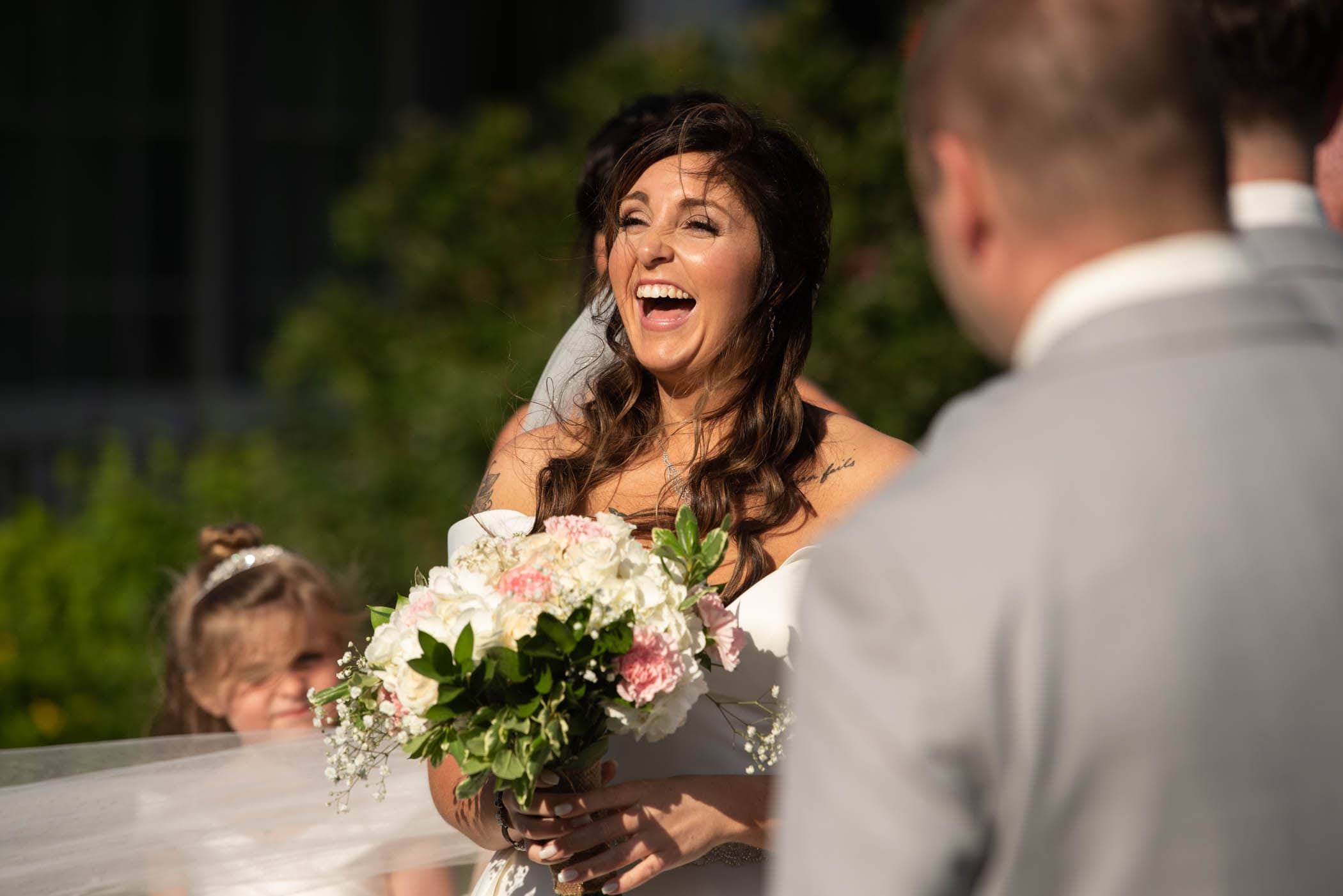 Smiling and laughing bride during wedding ceremony Dataw Island Club House by Susan DeLoach Photography SC wedding photographers