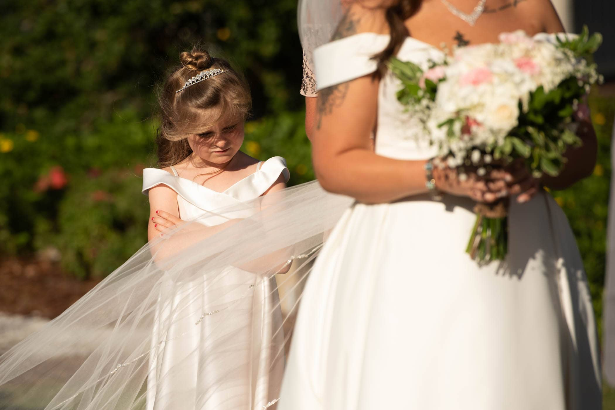 Pouting flower girl at wedding Dataw Island Club House by Susan DeLoach Photography SC wedding photographers