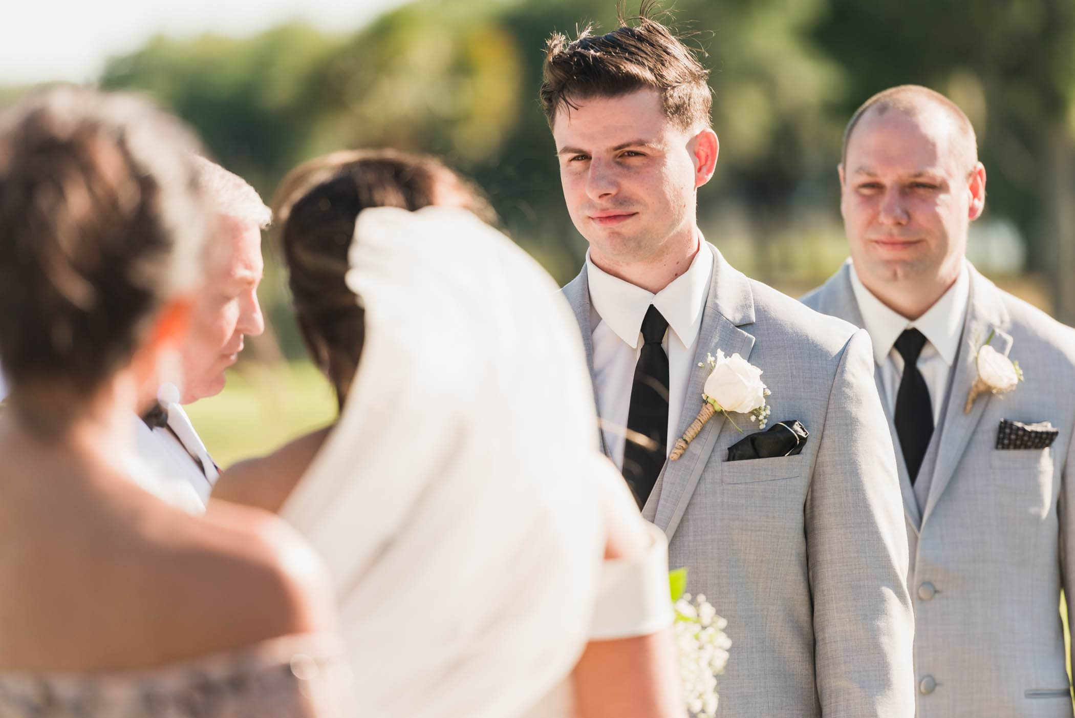 Groom looking at bride during wedding ceremony Dataw Island Club House by Susan DeLoach Photography SC wedding photographers