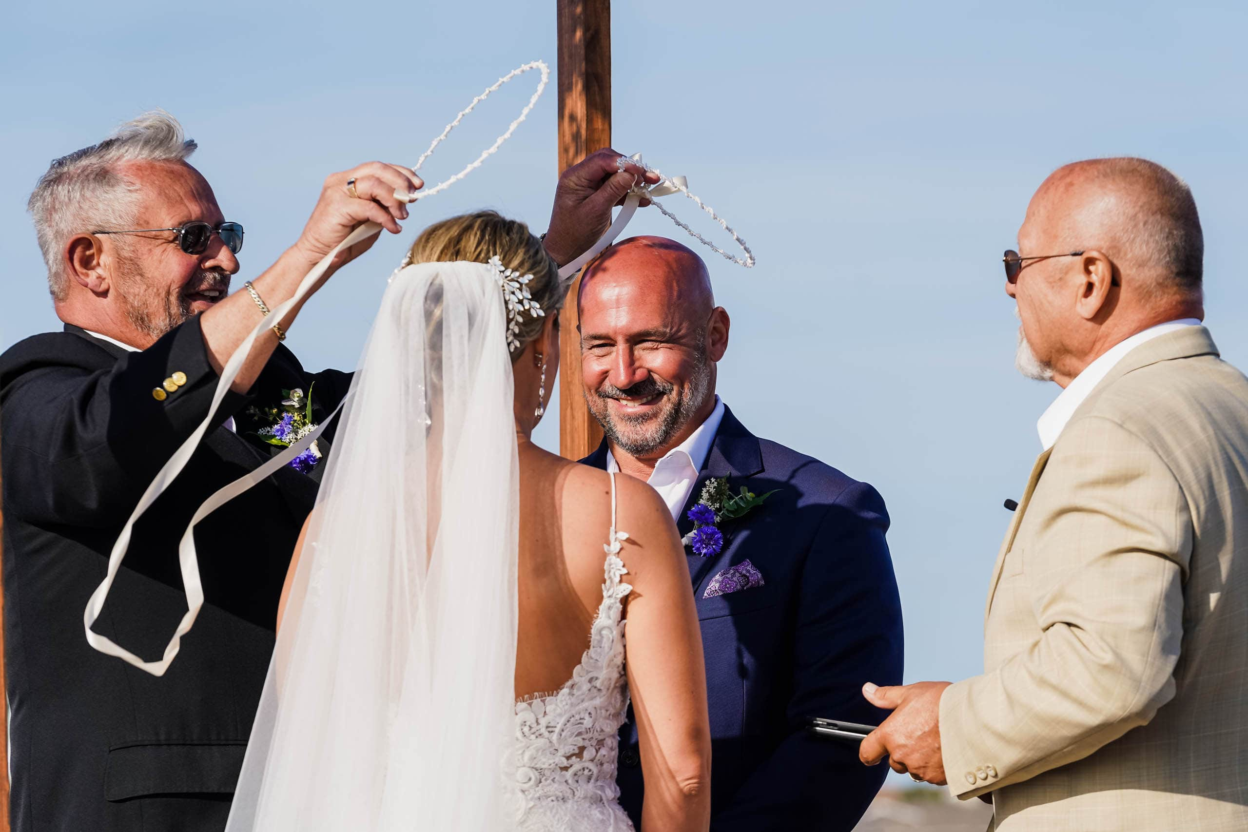 Bride and Groom Greek Crown Ceremony at Beach Wedding by Susan DeLoach Photography
