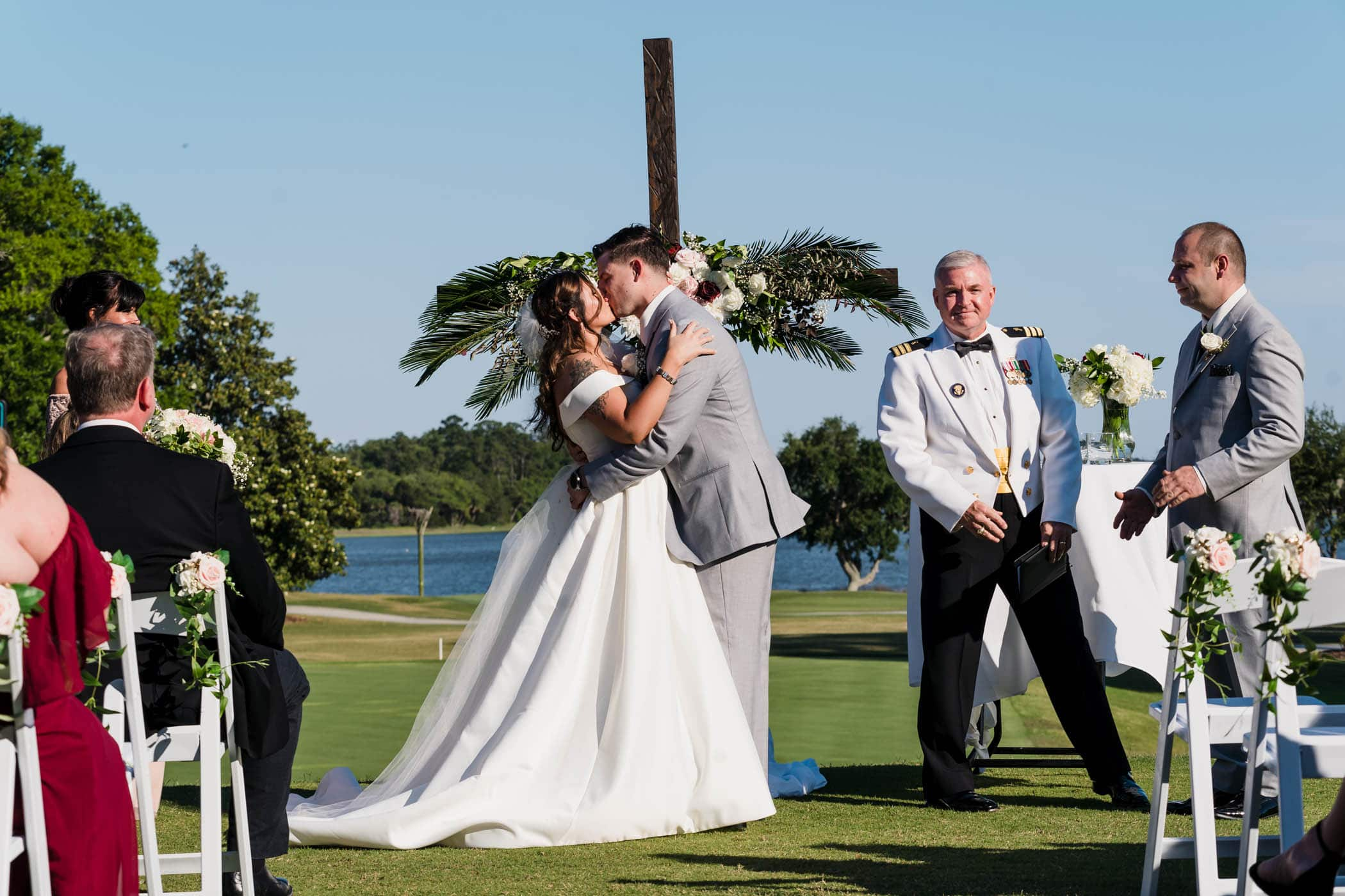 Bride and groom kissing at wedding ceremony Dataw Island Club House by Susan DeLoach Photography SC wedding photographers