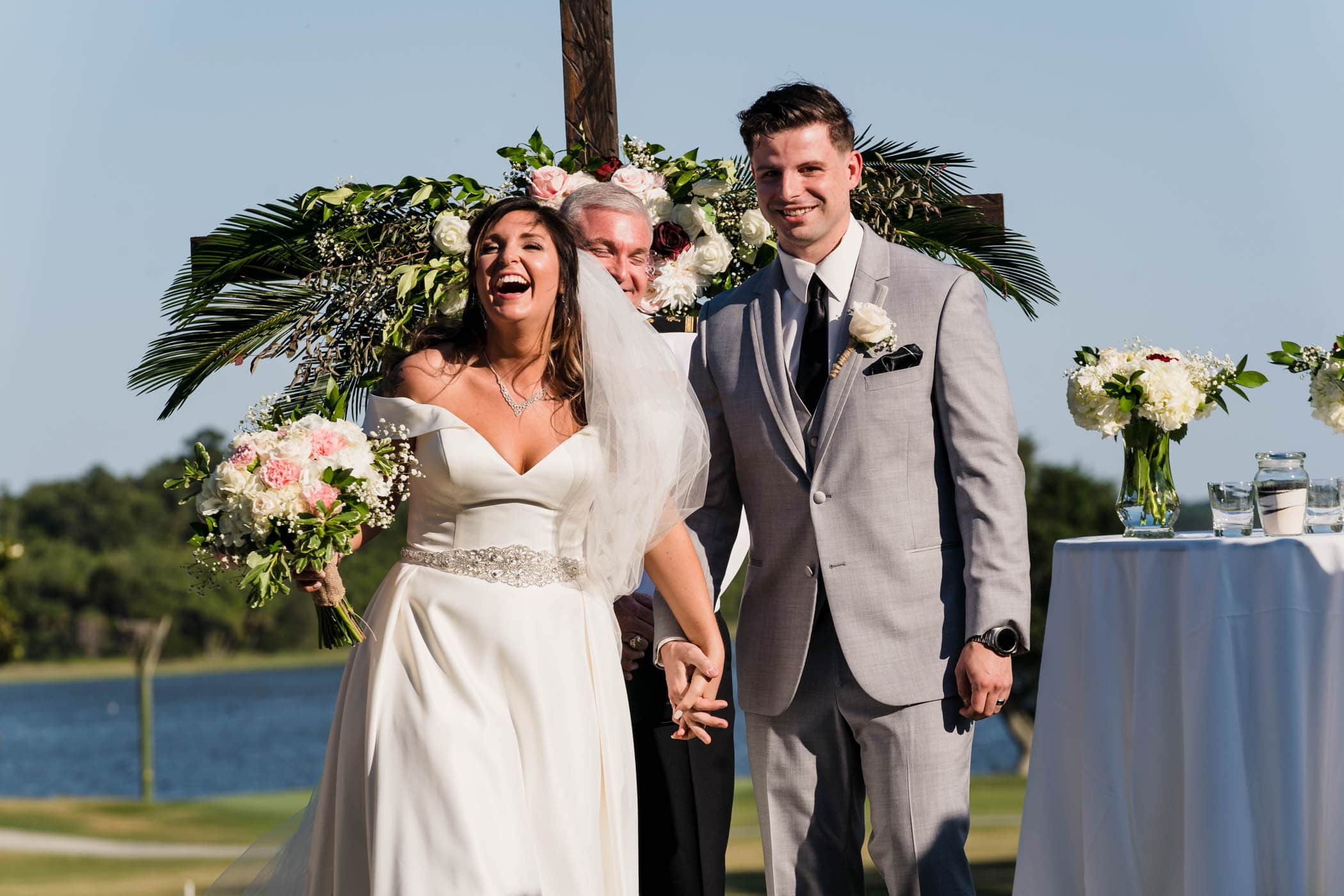 Happy Bride and Groom during recessional at wedding Dataw Island Club House by Susan DeLoach Photography SC wedding photographers