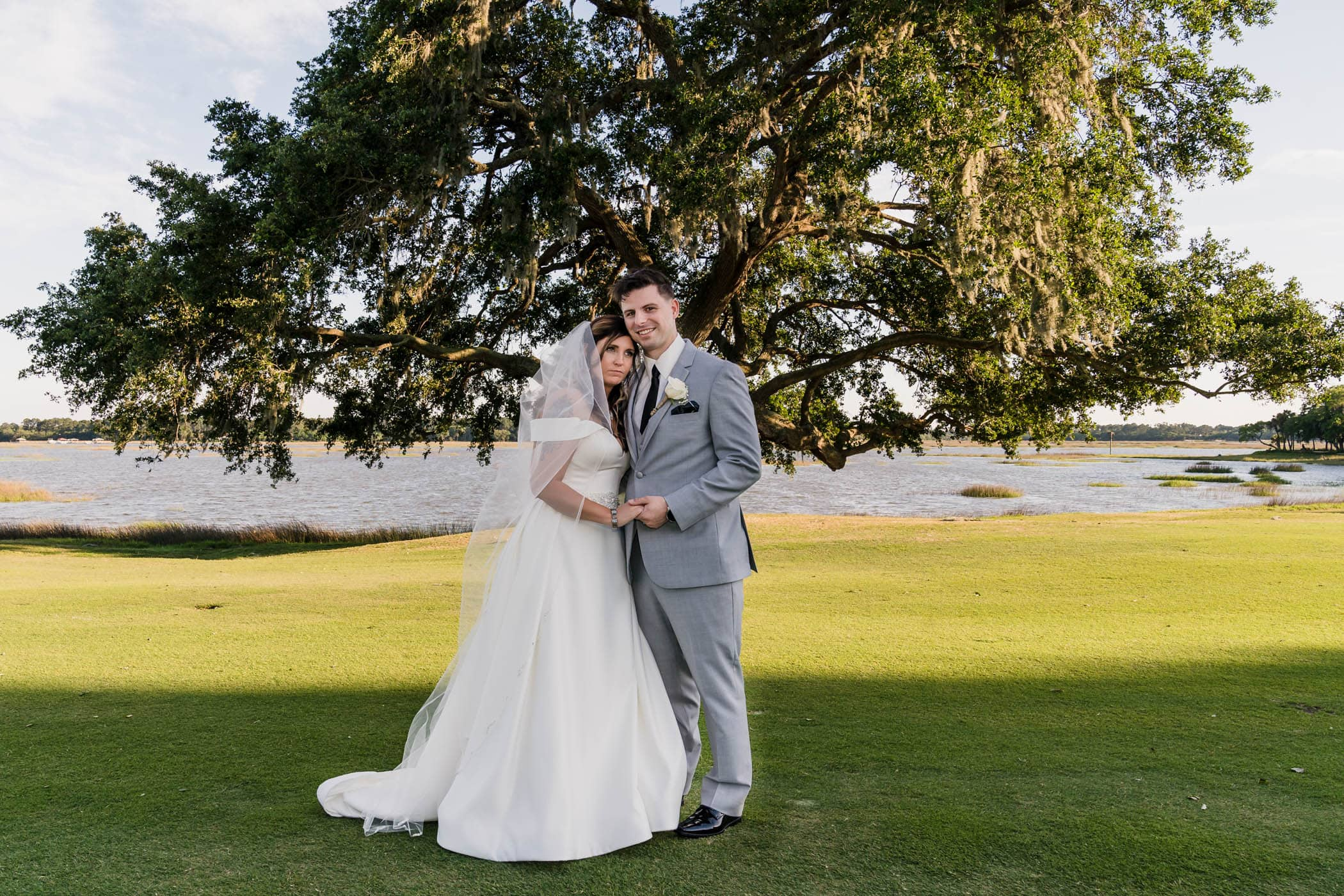 Bride and groom portrait with her head on his shoulder Dataw Island Club House by Susan DeLoach Photography SC wedding photographers