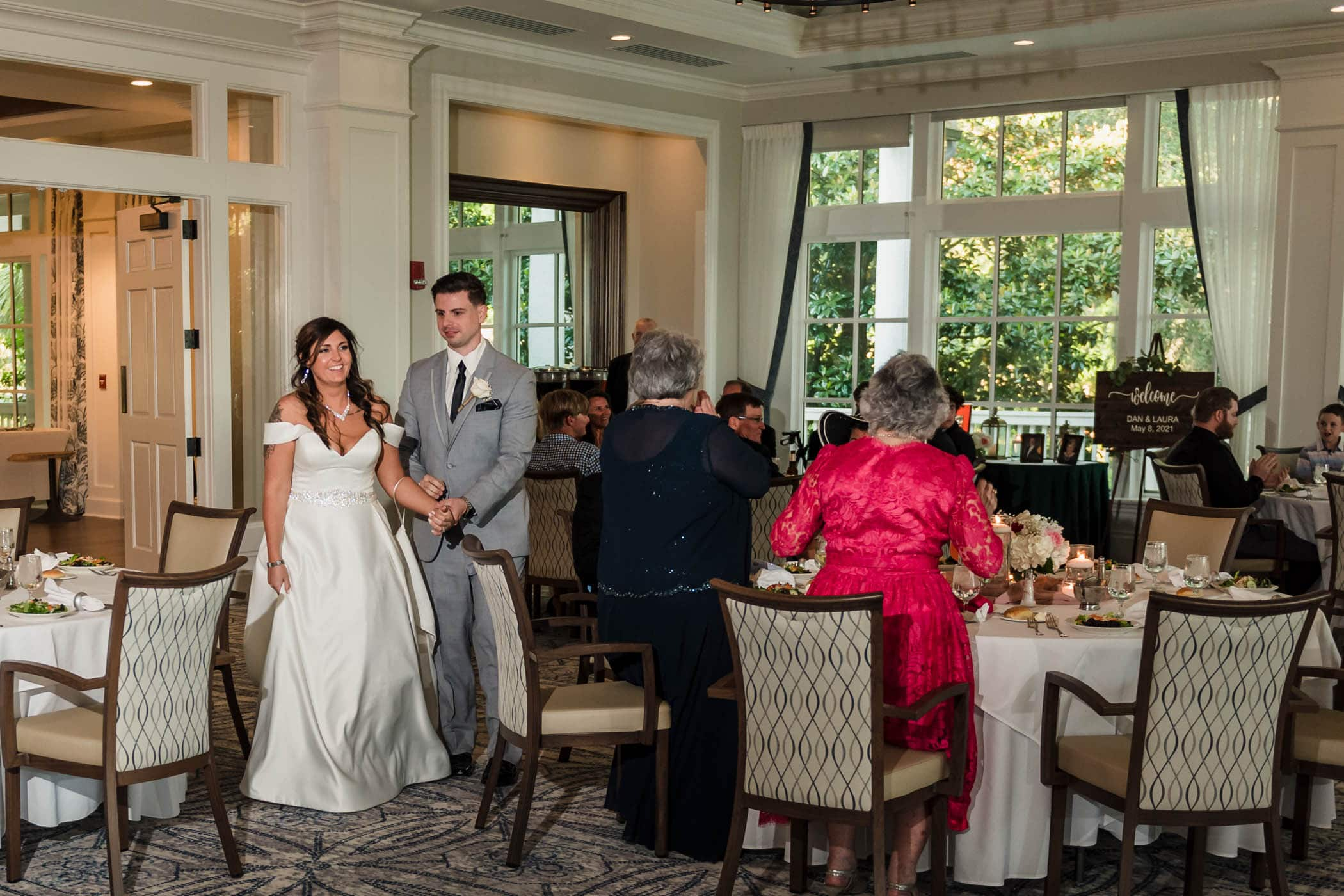 Grand entrance of the bride and groom at the reception Dataw Island Club House by Susan DeLoach Photography SC wedding photographers