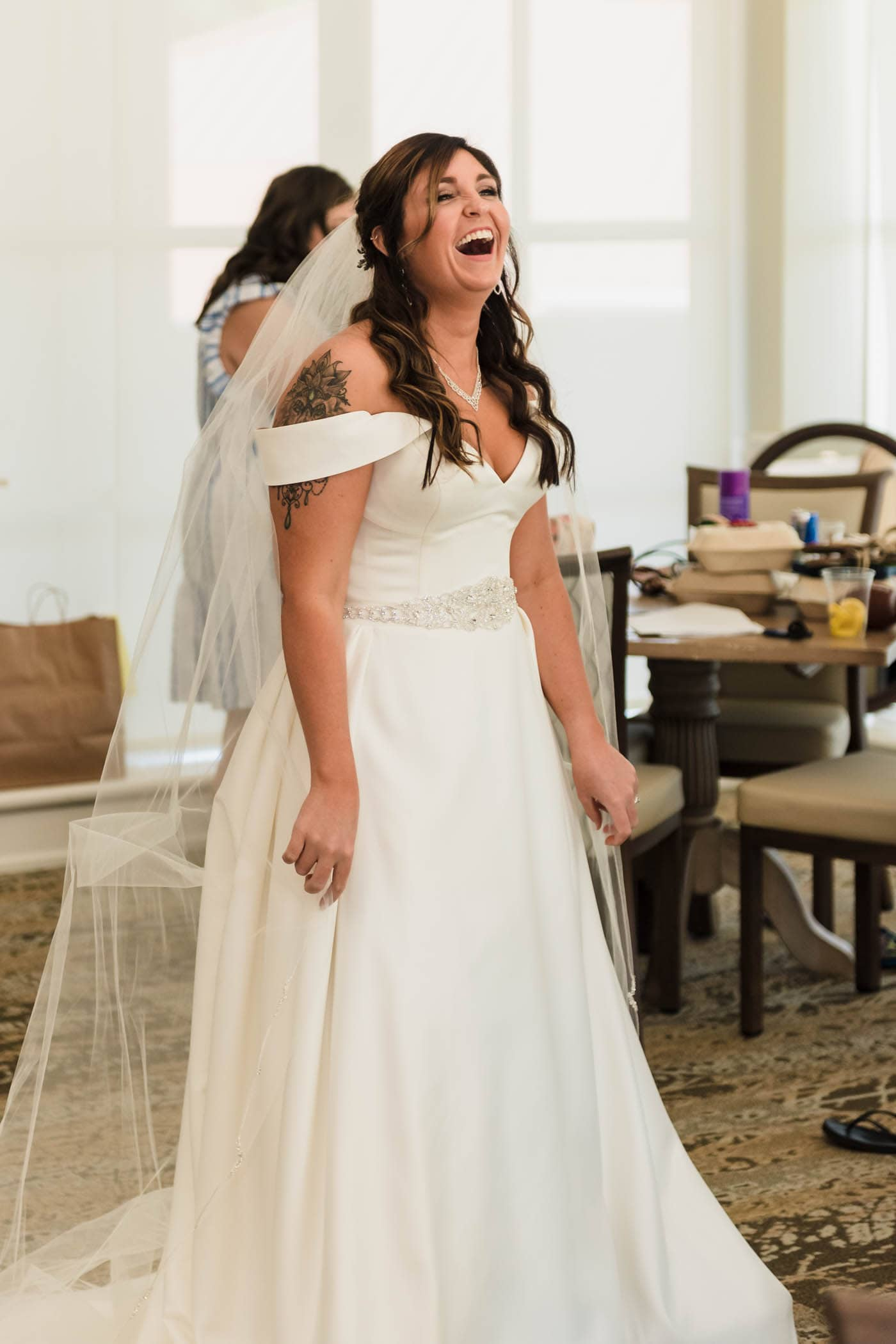 Bride wearing wedding dress and veil laughing by Susan DeLoach Photography SC wedding photographers