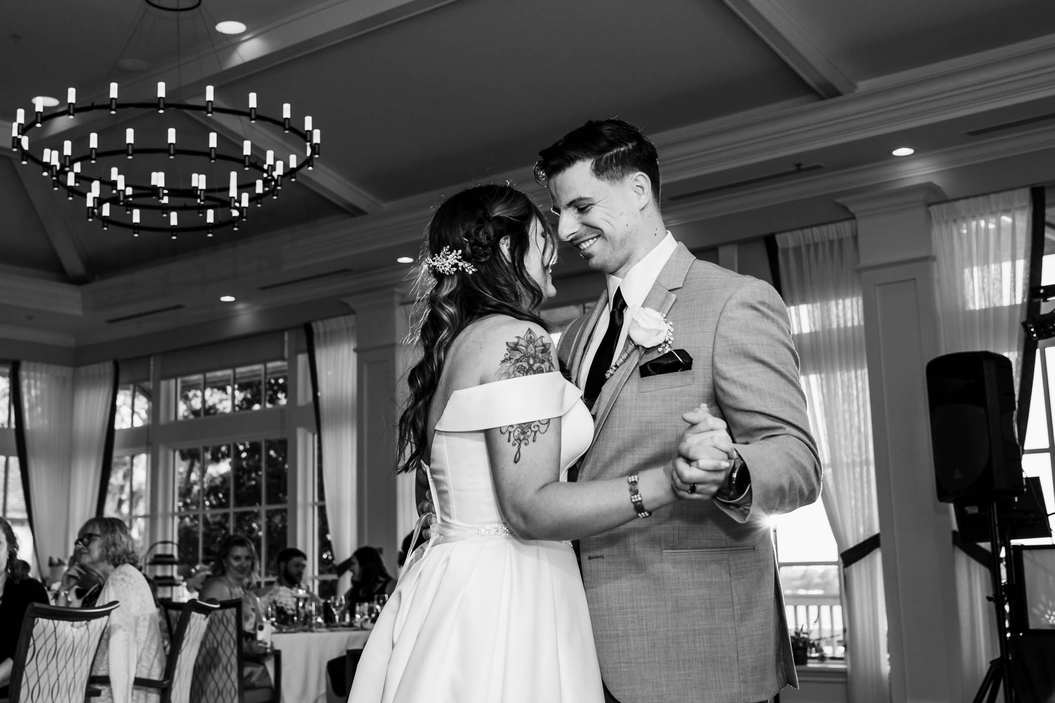 Bride and smiling groom dancing Dataw Island Club House by Susan DeLoach Photography SC wedding photographers