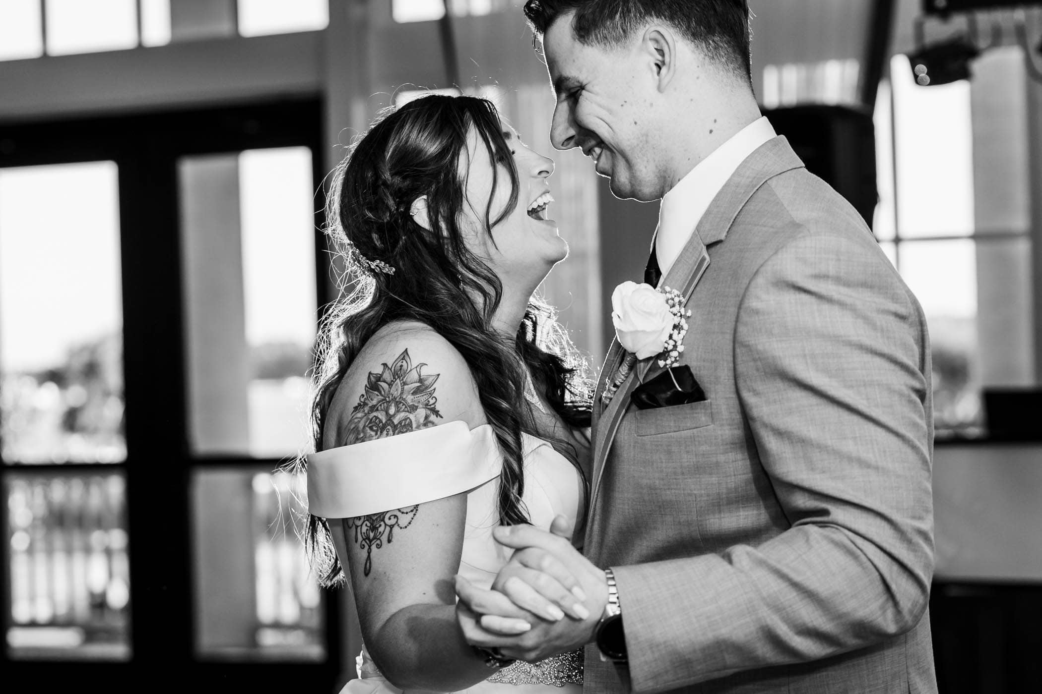 Bride and groom laughing while dancing Dataw Island Club House by Susan DeLoach Photography SC wedding photographers