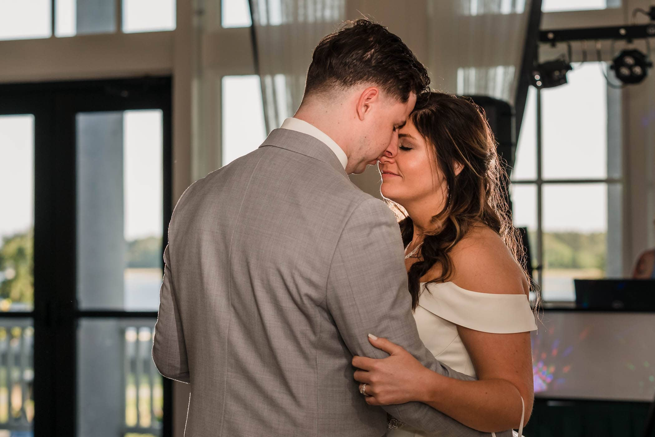 Smiling bride dancing with the groom Dataw Island Club House by Susan DeLoach Photography SC wedding photographers