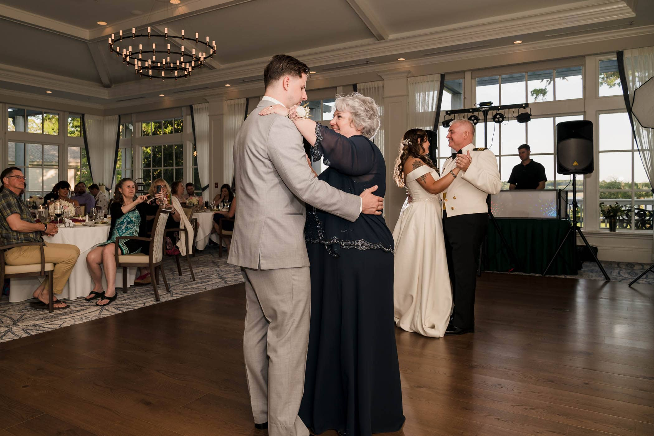 Bride with father, Groom with mother dancing on the dance floor at the same time Dataw Island Club House by Susan DeLoach Photography SC wedding photographers