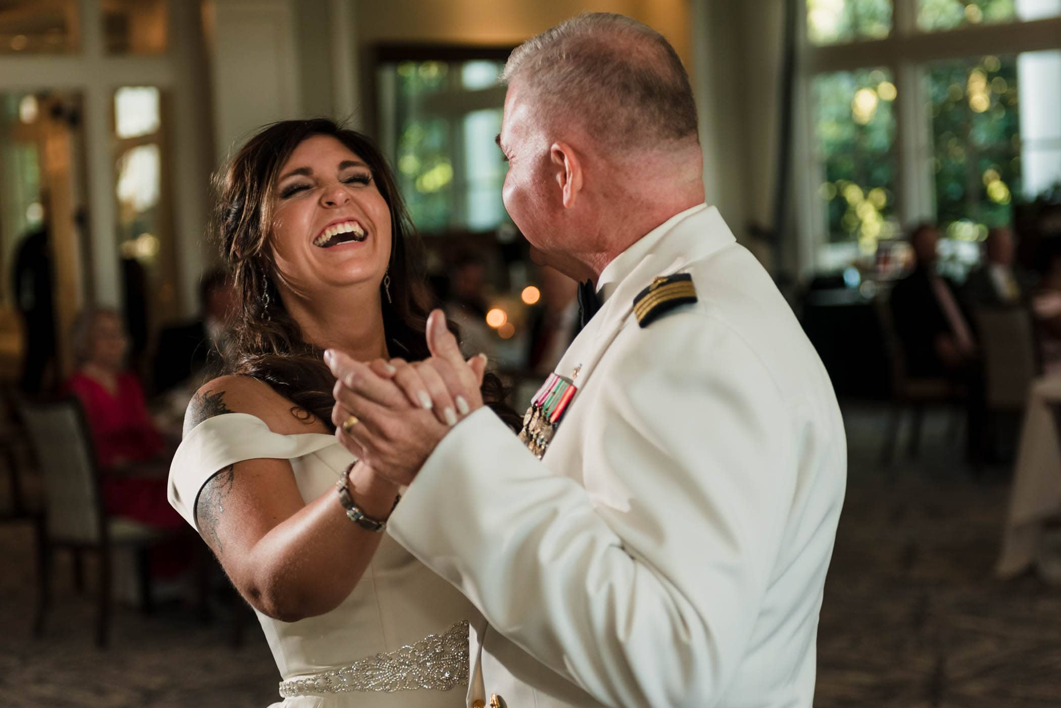 Laughing bride dancing with her father Dataw Island Club House by Susan DeLoach Photography SC wedding photographers
