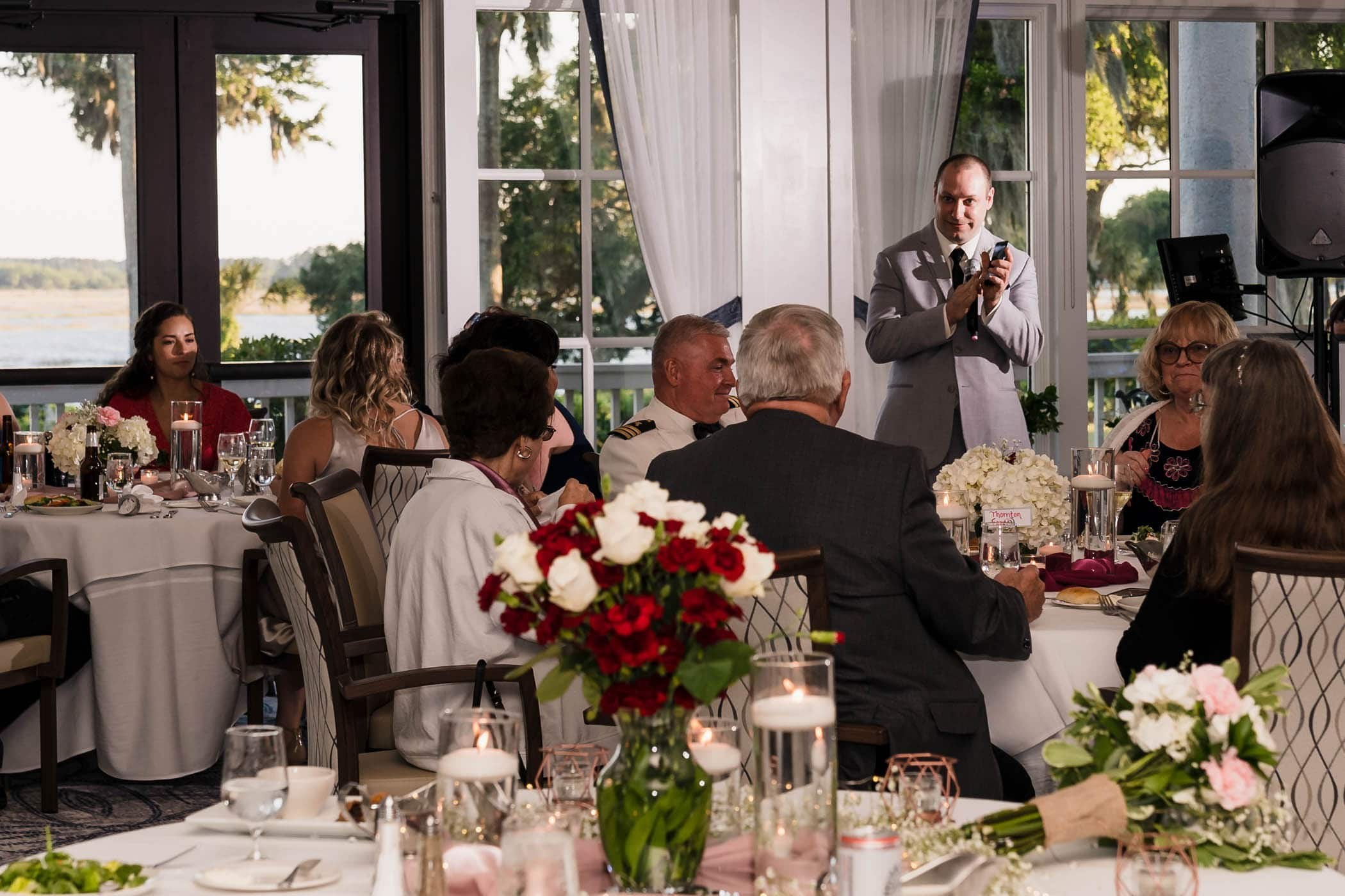 Best Man at a wedding giving a toast Dataw Island Club House by Susan DeLoach Photography SC wedding photographers
