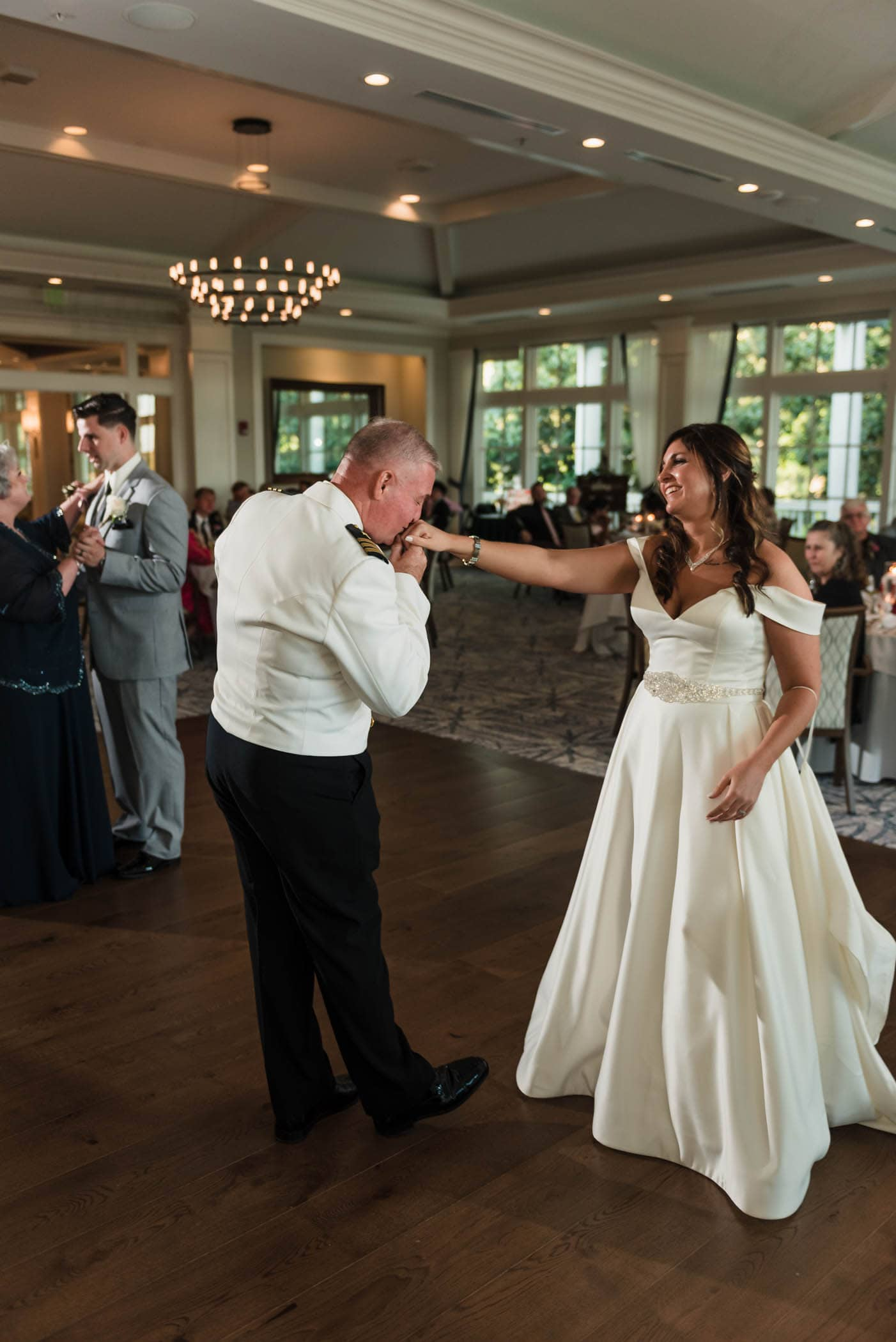 Father of the Bride kissing her hand on the dance floor Dataw Island Club House by Susan DeLoach Photography SC wedding photographers