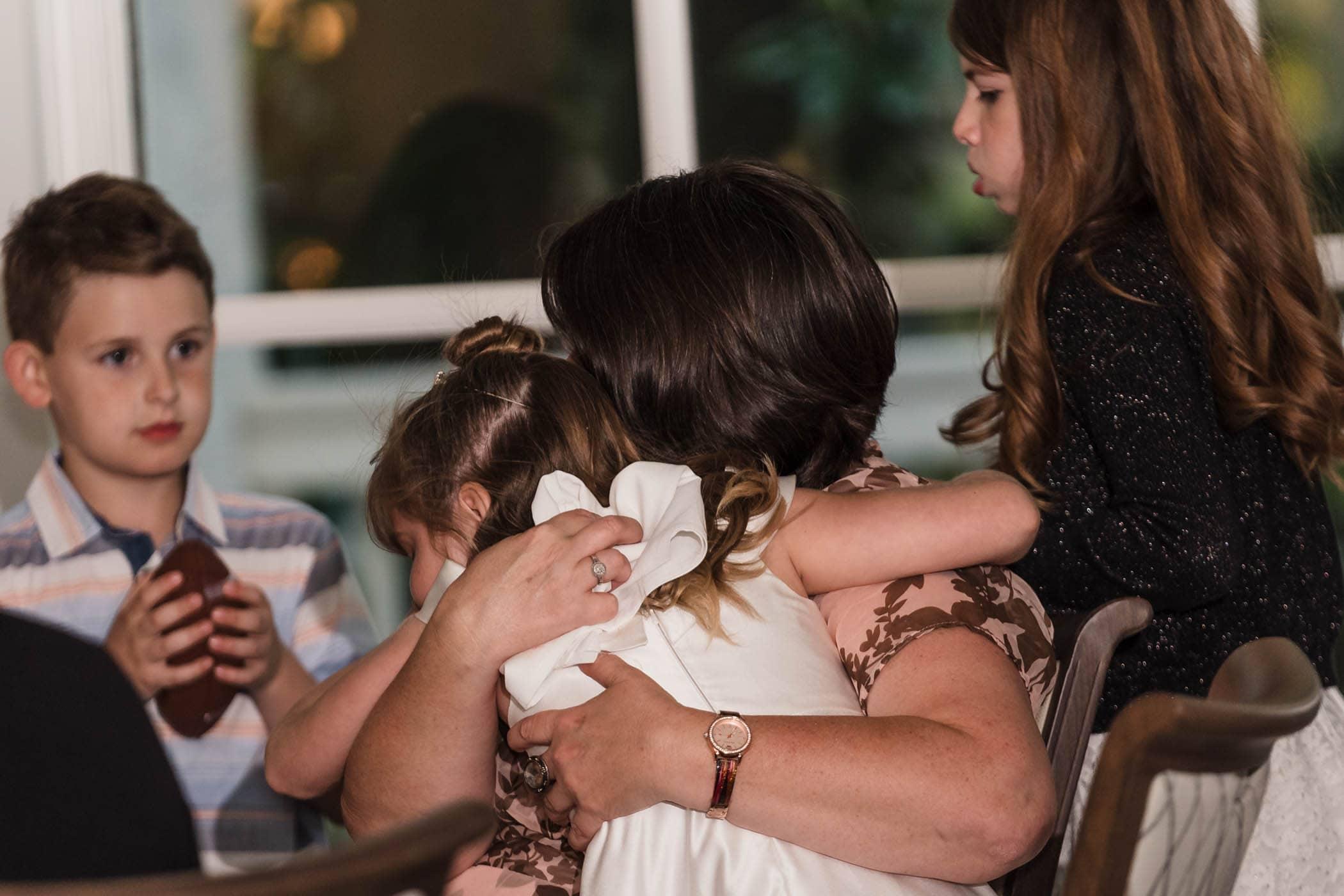 Women hugging child at a wedding Dataw Island Club House by Susan DeLoach Photography SC wedding photographers