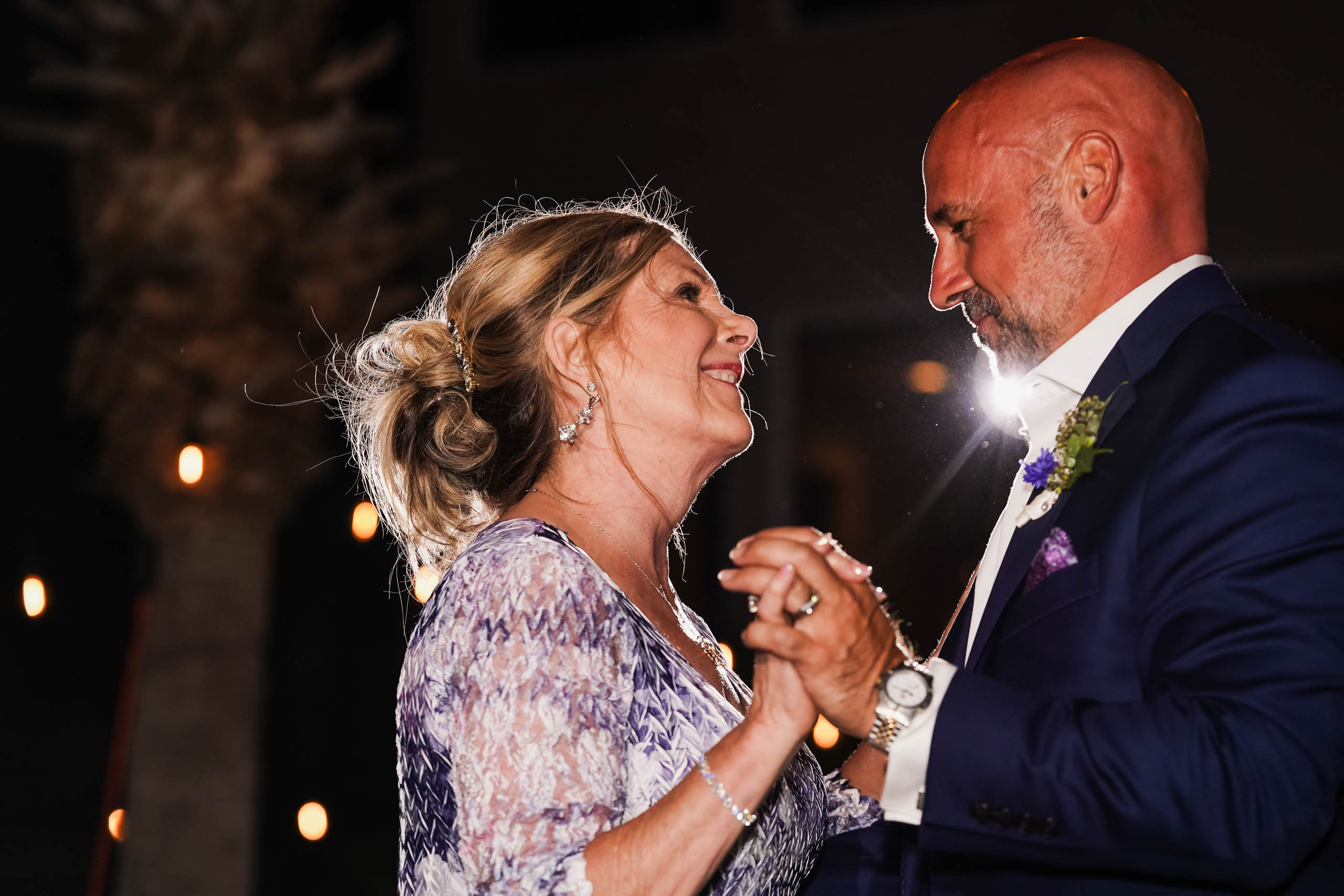 Groom dancing with the mother of the bride at Fripp Island beach wedding by Susan DeLoach Photography SC wedding photographer