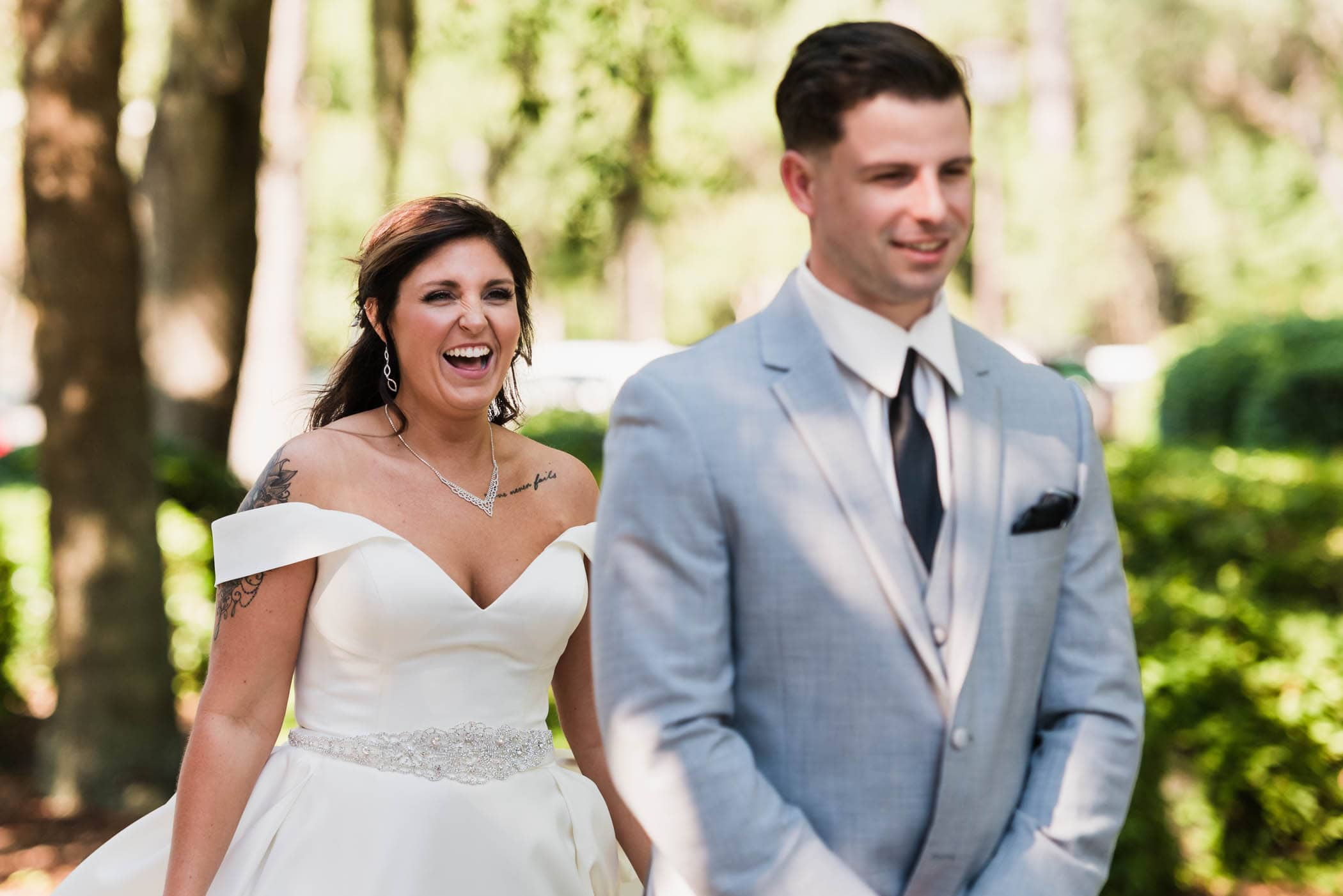 Brides face as she walks up behind her groom for the first look by Susan DeLoach Photography SC wedding photographers